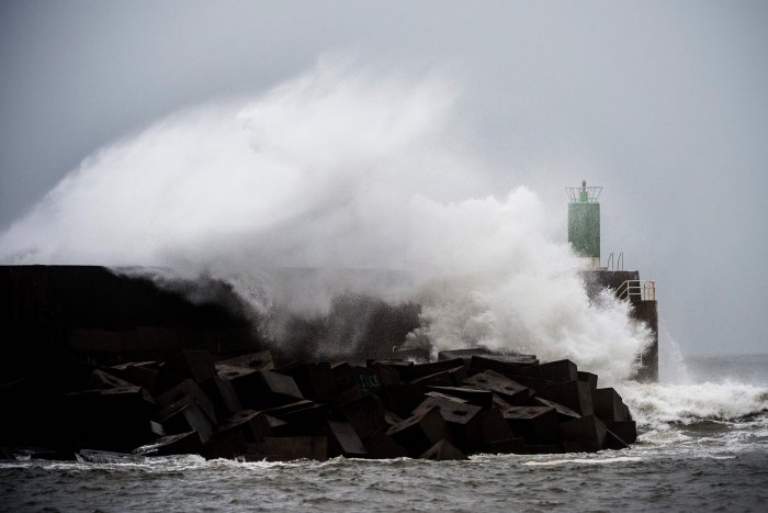 Waves hit the jetty of the port of A Guarda, northwestern Spain, during the storm Fabien. (AFP Photo)