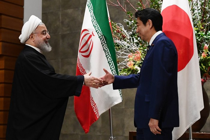 Iranian President Hassan Rouhani, left, and Japanese Prime Minister Shinzo Abe, right, shake hands before their meeting at the prime minister's office in Tokyo. (PTI Photo)