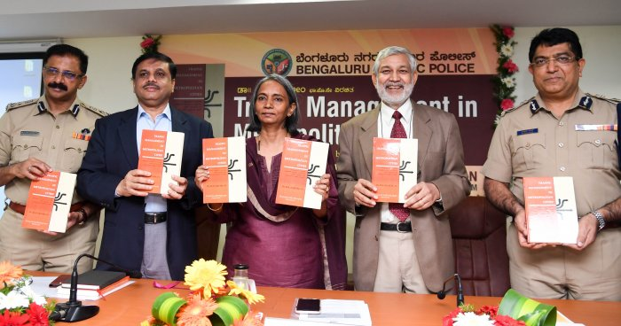 Neelamani N. Raju, DG & IGP release the book ' Traffic Management in Metropolitan Cities', author by Dr M A Saleem(second from Left), organised by Bangalore City Traffic Police, at Traffic Management Center Auditorium, in Bengaluru. (DH Photo)