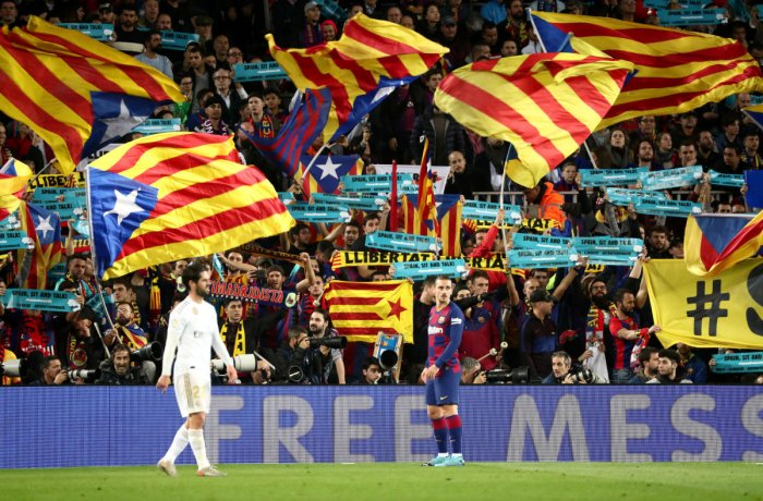 General view as fans inside the stadium wave Estelada flags and hold up banners during the match. (Reuters photo)