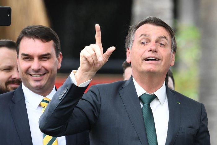 Brazilian President Jair Bolsonaro (R) with his son, senator Flavio Bolsonaro. (AFP photo)