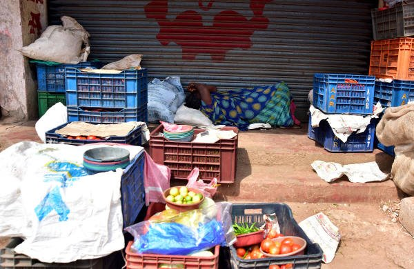 In the absence of any business a road-side vendor is forced to seek refuge in a nap near the central market in Mangaluru on Friday. (Photo by GovindraJ Javli)