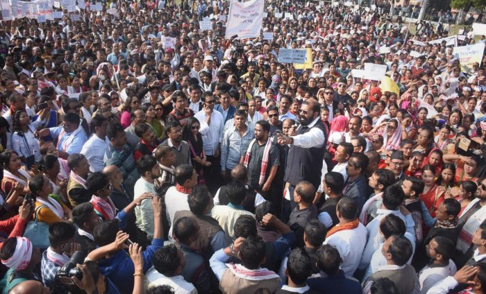 All Assam Students Union (AASU) Chief Advisor Samujjal Bhattacharya speaks during a procession demanding withdrawal of the Citizenship Amendment Act (CAA), in Guwahati. PTI