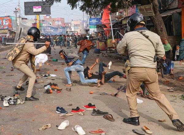 Police personnel baton charge at protestors during their rally against NRC and amended Citizenship Act that turned violent, in Lucknow, Thursday, Dec. 19, 2019. (PTI Photo)