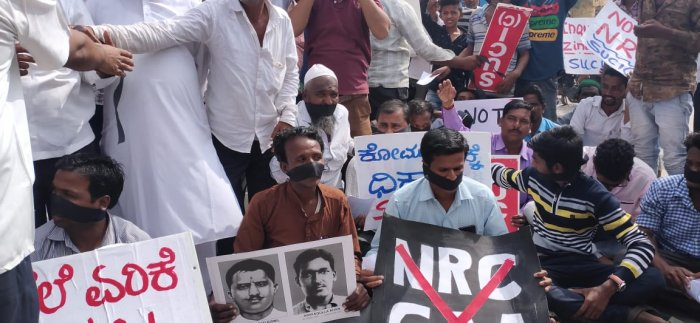 They were staging the protest against Citizenship (Amendment) Act, a rise in prices of essential commodities and unemployment by holding placards. (DH photo)