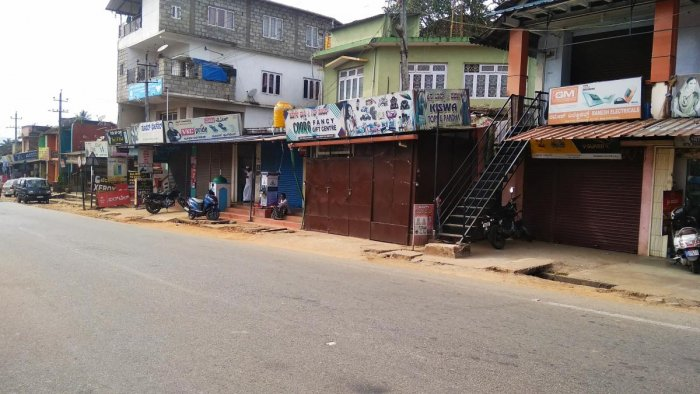 Members of Muslim community voluntarily supported the bandh call given by Kodagu Muslim Hitharakshana Vedike, by shutting down their business establishments in Suntikoppa, against the police firing, which killed two youths in Mangluru on Thursday. DH Phot