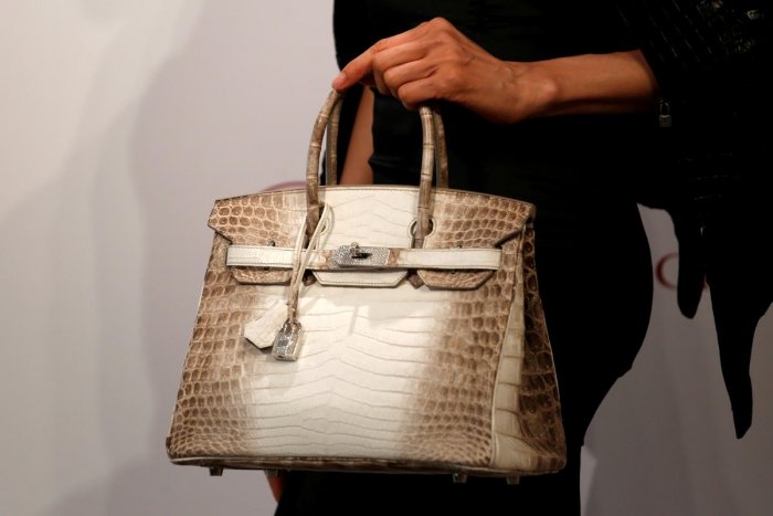 A model carries a Hermes signature Birkin with Himalayan crocodile leather and diamonds, sold for $300,168 at a Christie's auction on May 30, 2016. (Reuters Photo)
