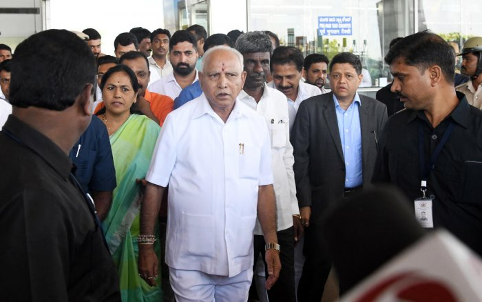 Chief Minister B S Yediyurappa arrives for a meeting with leaders of Muslim and Christian communities at Circuit House on Saturday.