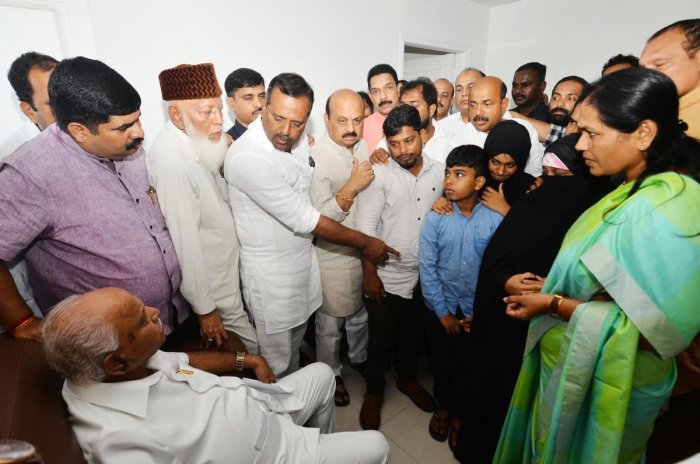 Chief Minister BSYediyurappa interacts with the families of people who died in the police firing at Circuit House, Mangaluru, on Saturday.