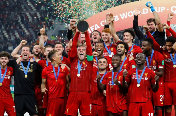 Liverpool's Jordan Henderson lifts the trophy as they celebrate after winning the Club World Cup. (Reuters Photo)