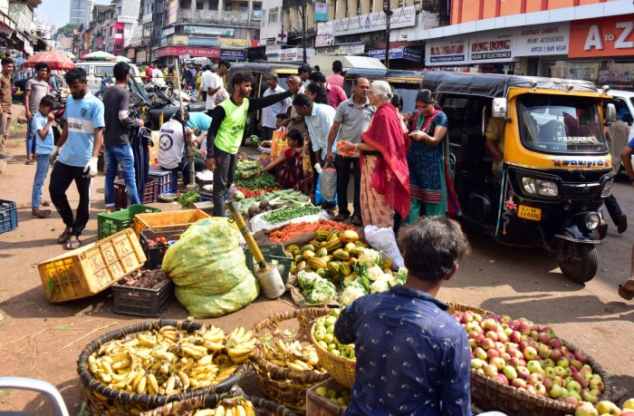 Street vendors sell vegetables and fruits at Central Market in Mangaluru.