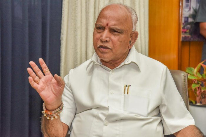 """""""I request both Siddaramaiah and Kumaraswamy to explain how it might affect minorities. Without having any knowledge of that, they are deliberately confusing people,"""" he said CM Yediyurappa. DH Photo"""