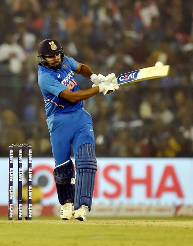 Indian batsman Rohit Sharma plays a shot during the 3rd and final One Day International (ODI) match at Barabati Stadium, in Cuttack. (PTI Photo)