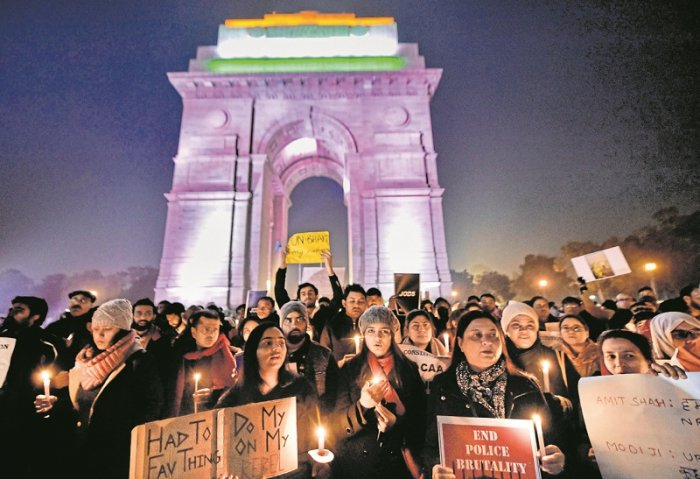 Members of Jamia Teachers Association (JTA) stage a candle light march against the amended Citizenship Act, at India Gate in New Delhi. (PTI Photo)
