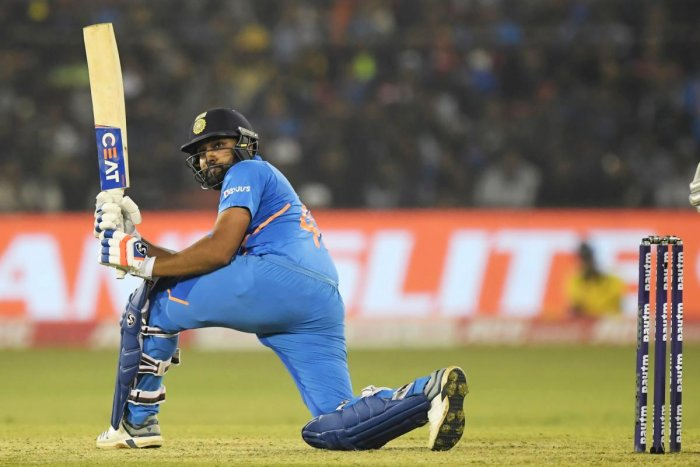 India's Rohit Sharma plays a shot during the third one day international cricket match of a three-match series between India and West Indies at the Barabati Stadium in Cuttack. (AFP Photo)