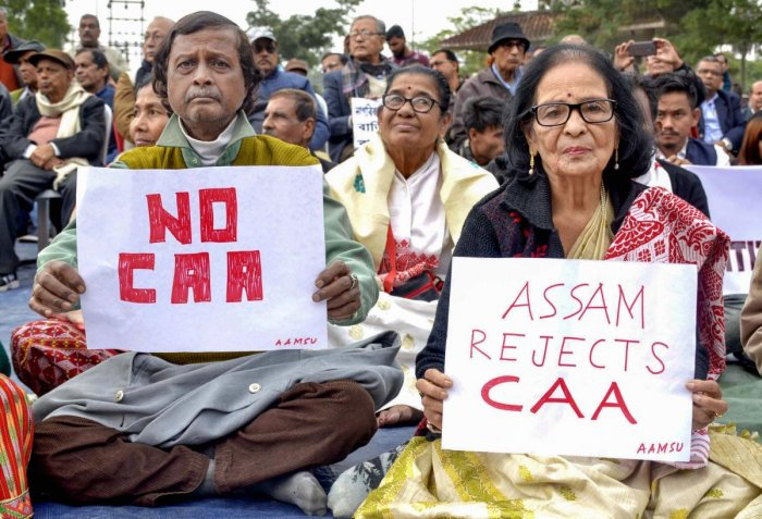 Senior citizens display placards during a protest against the Citizenship (Amendment) Act, at Latashil Playground in Guwahati