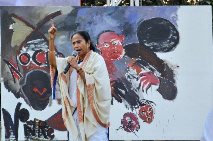 West Bengal CM, Mamata Banerjee addressing a rally in Kolkata. (PTI Photo)