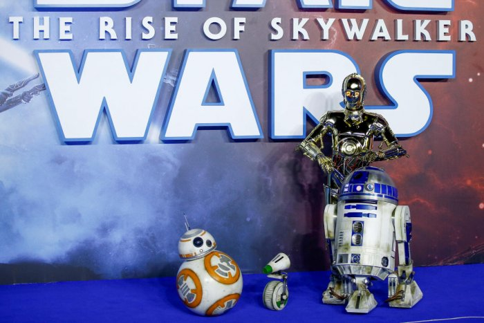 "Star Wars robots R2-D2 and BB8 and droids C3P0 and D-0 pose as they attend the premiere of ""Star Wars: The Rise of Skywalker"" in London. (Reuters Photo)"
