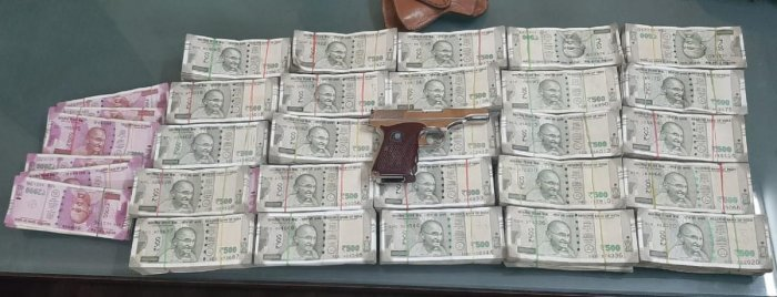 The pistol and the Rs 28 lakh in cash seized from the four-member gang in Bengaluru on Saturday night. PIC COURTESY: POLICE