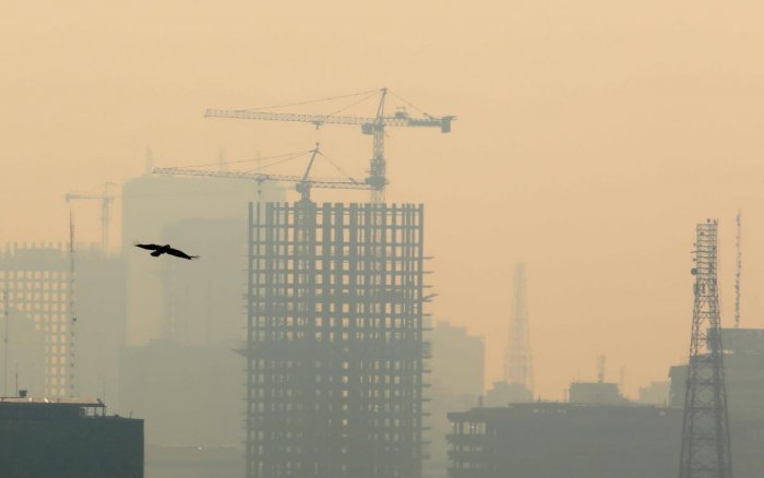 Air pollution covers the Iranian capital Tehran on December 23, 2019. - Schools in Iran's Tehran province have been ordered shut until due to severe air pollution, authorities announced, extending their closure to a full week. AFP