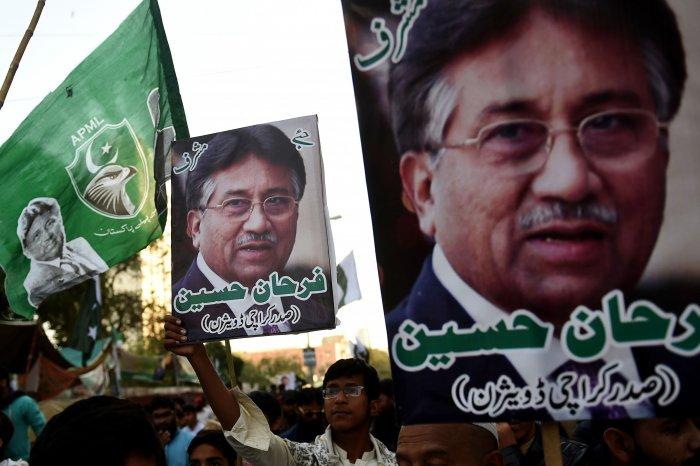 Demonstrators carry pictures of former military ruler Pervez Musharraf. (PTI Photo)