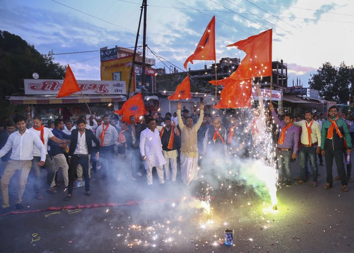 Hindu refugees from Pakistan burst firecrackers with member of Vishwa Hindu Parishad (VHP) as they celebrate the approval of the government's Citizenship Amendment Bill. (PTI Photo)