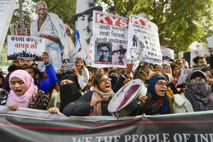 Protestors display placards and raise slogans as they gather for a demonstration demanding withdrawal of Citizenship Amendment Act (CAA). PTI