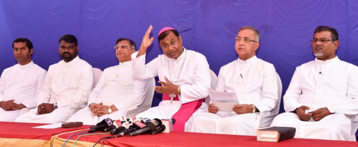 Bishop K A William speaks during a media conference, in Mysuru, on Monday. His assistant Avinash, MDES secretary Vijay Kumar, vicar general for health and education Leslie Moras, vicar general C Rayappa and MDES financial administrator James are seen. dh