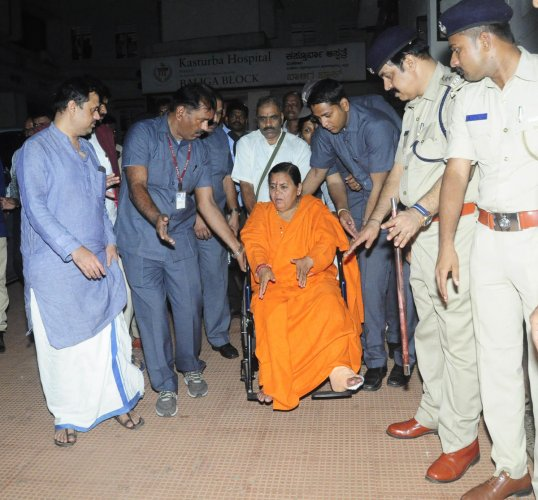 Former union minister Uma Bharti comes out after visiting Pejawar Mutt seer Vishwesha Teertha Swami at KMC in Manipal on Monday.