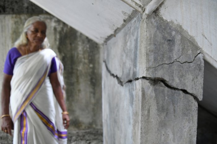 Harshamma, residing near Alfa Serene apartment, showing the cracks developed at her house following the preliminary demolition activities at the apartment