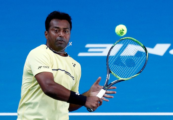 India's Leander Paes in action during the match against Germany's Anna-Lena Groenefeld and Colombia's Robert Farah. (Reuters Photo)