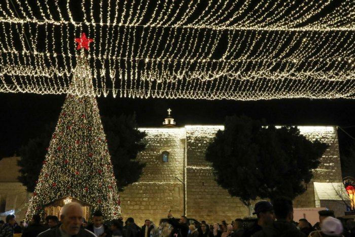 Tourists and pilgrims visit the Manger Square outside the Church of the Nativity in the biblical West Bank city of Bethlehem on December 24, 2019. Photo/AFP