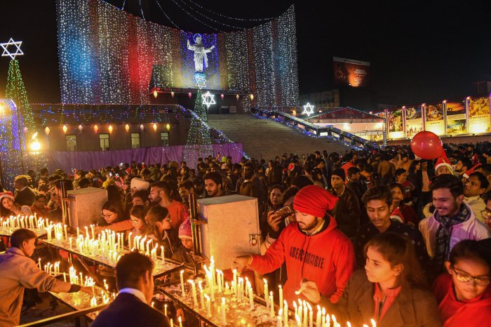 Devotees offer prayers at the St. Cathedral Church on the occasion of Christmas in Lucknow. (PTI Photo)