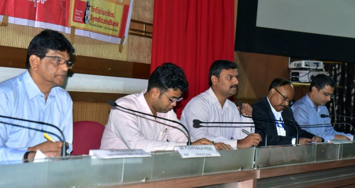 Zilla Panchayat CEO Dr R Selvamani speaks at a district consultative committee meeting in Mangaluru.