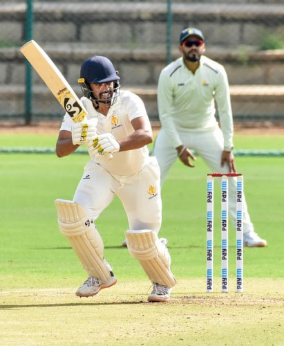 Karnataka captain Karun Nair (left) came up with a timely half century to keep the hosts' heads above the water against Himachal Pradesh in Mysuru on Wednesday. Haryana pacer Kanwar Abhinay grabbed five wickets. DH Photos/ SAVITHA BR