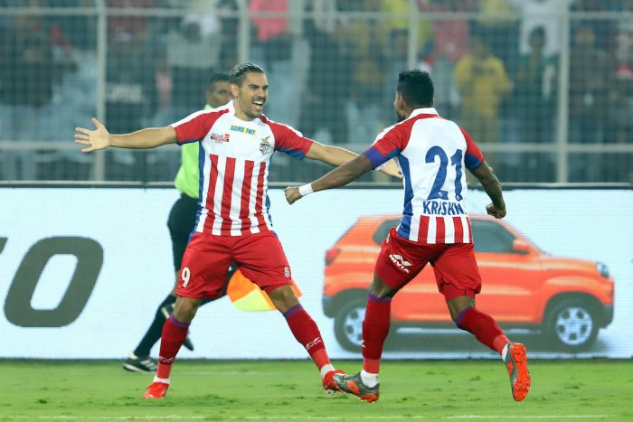 ATK's David Williams (left) celebrates with Roy Krishna after scoring the winner against Bengaluru FC on Wednesday.