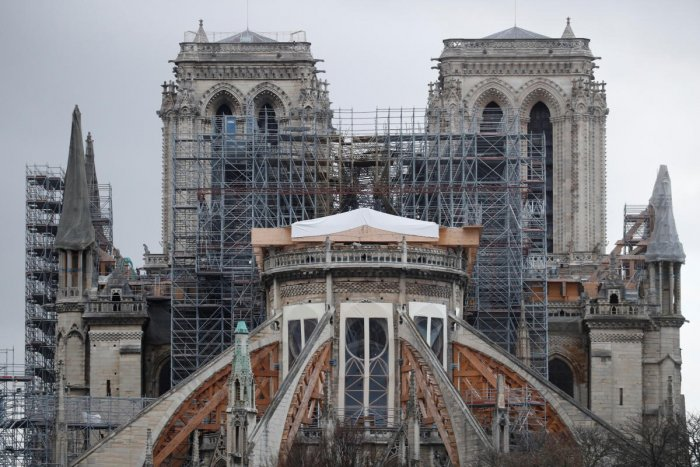 Meanwhile, workers continue to repair and rebuild the cherished cathedral. Photo/Reuters