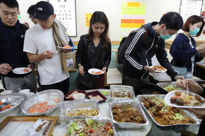 """Kwong Wing Catering is one of many businesses that are part of the so-called """"yellow economy"""" across Hong Kong that are known for their support of the pro-democracy campaign. Photo/Reuters"""