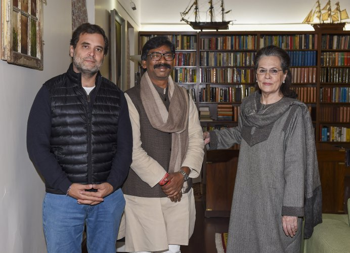 Jharkhand Chief Minister-designate Hemant Soren meets Congress interim President Sonia Gandhi and party leader Rahul Gandhi at Sonia's residence in New Delhi. (PTI Photo)