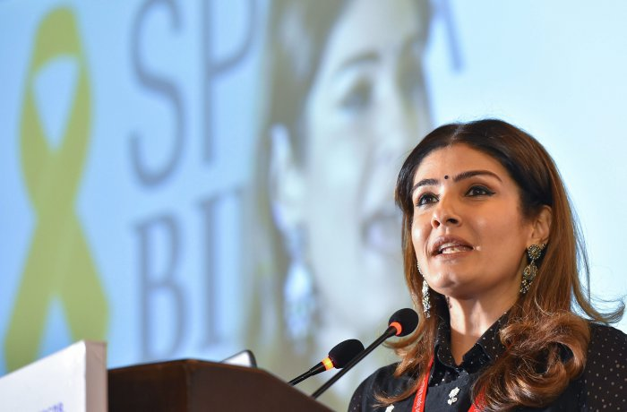 Bollywood actress Raveena Tandon speaks during the inauguration of the 28th International Conference on Spina Bifida and Hydrocephalus in New Delhi. (PTI Photo)