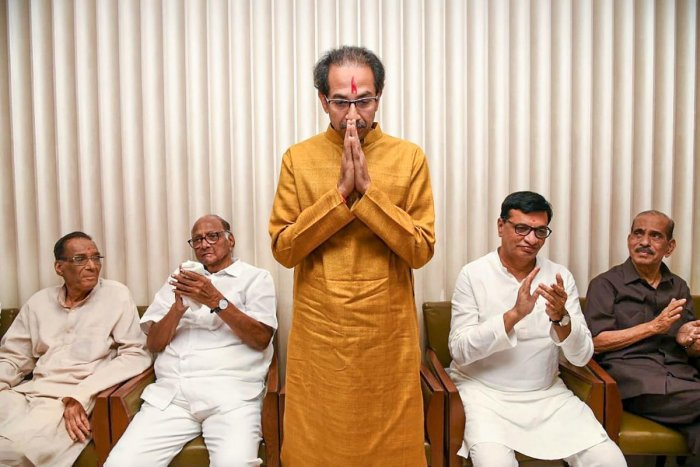 Shiv Sena President Uddhav Thackeray gestures after he was chosen as the nominee for Maharashtra chief minister's post by Shiv Sena-NCP-Congress alliance, during a meeting in Mumbai, Tuesday, Nov. 26, 2019. (PTI Photo)