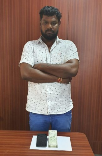 The Central Crime Branch arrested 40-year-old Ravi Mahadev Naik who was running an online betting racket in JP Nagar 1st Phase on Tuesday. PHOTO COURTESY: POLICE