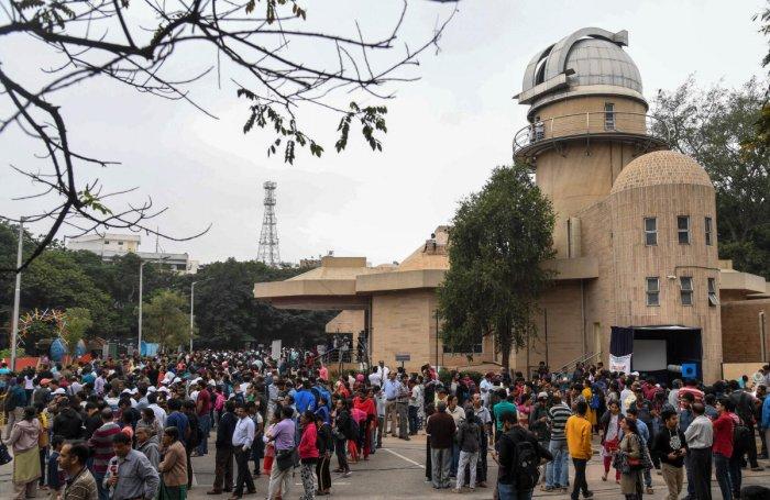 People gather to watch the annular solar eclipse at Jawaharlal Nehru Planetarium (JNP) in Bengaluru on Thursday. Photo/ B H Shivakumar