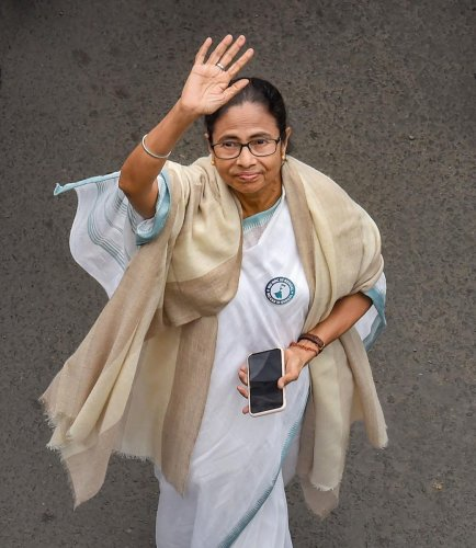 TMC Supremo and West Bengal Chief Minister Mamata Banerjee waves while leading a protest rally against the amended Citizenship Act and NRC, in Kolkata