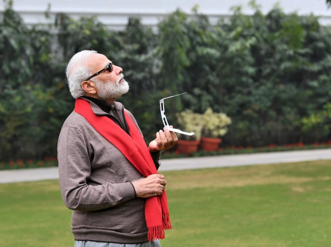 PM Modi tries to see the annular eclipse, tweets pictures of himself. (Twitter @narendramodi)