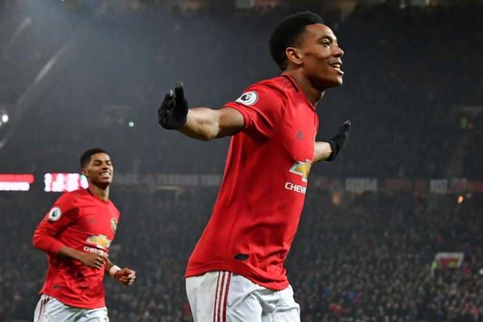 Manchester United's French striker Anthony Martial celebrates after scoring his second goal, the team's fourth during the English Premier League football match between Manchester United and Newcastle United at Old Trafford in Manchester, north west England. (AFP photo)
