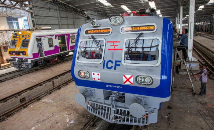 Central Railway's first air conditioned local train stands parked at the Kurla car shed, in Mumbai, Tuesday, Dec. 10, 2019. (PTI Photo)