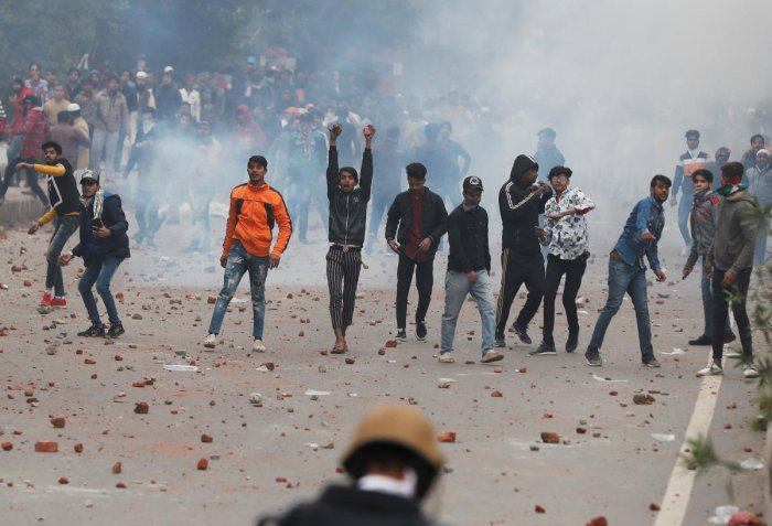 Demonstrators threw stones towards police during a protest against the amended Citizenship Act in Seelampur area of Delhi. (REUTERS)