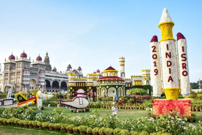 A replica of satellite launch and the Bengaluru palace replice with Mysuru Palace in the background at the flower show. DH PHOTOS/Savitha B R