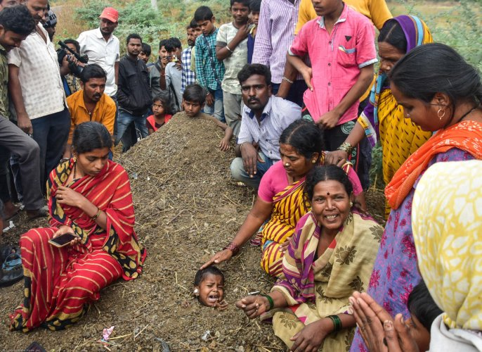 Two girls, aged 4 and 6, were buried neck-deep in the dirt, as part of a superstitious belief that the 'inhuman' practice observed during the solar eclipse would cure their ailments, at Tajsultanpur in Kalaburagi district. DH PHOTO